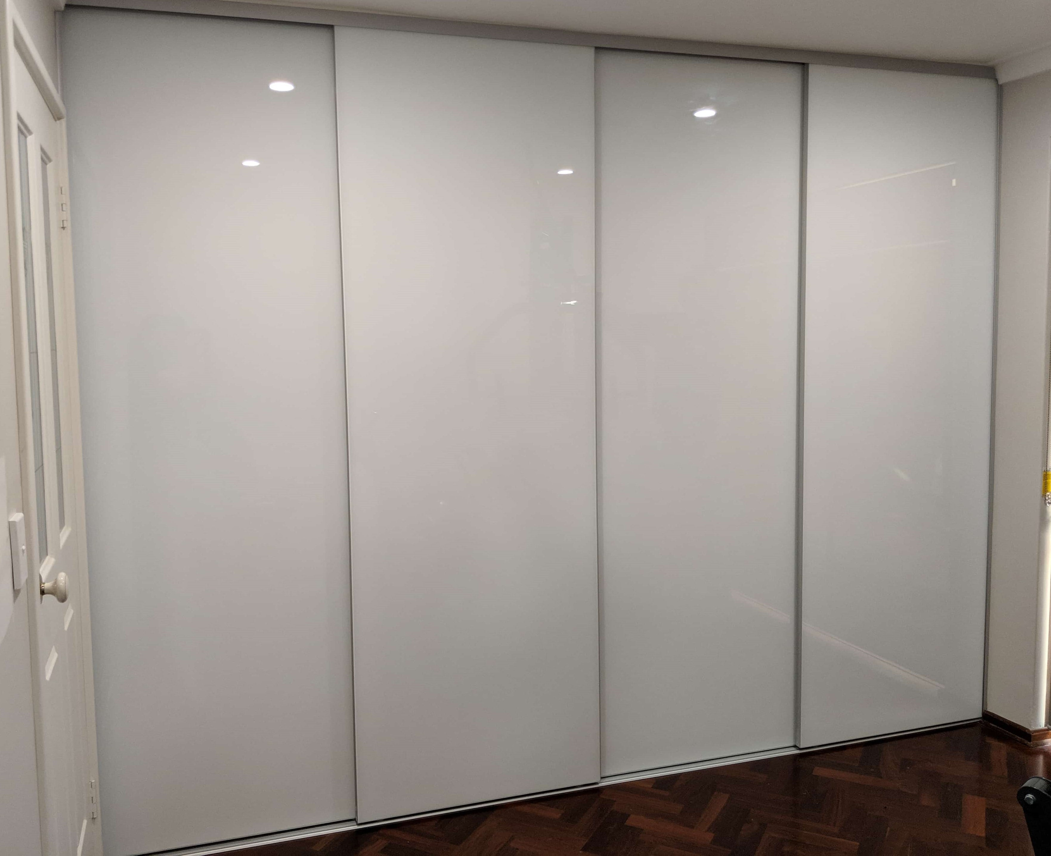 Four Door Frameless White Glass Sliding Wardrobe Doors