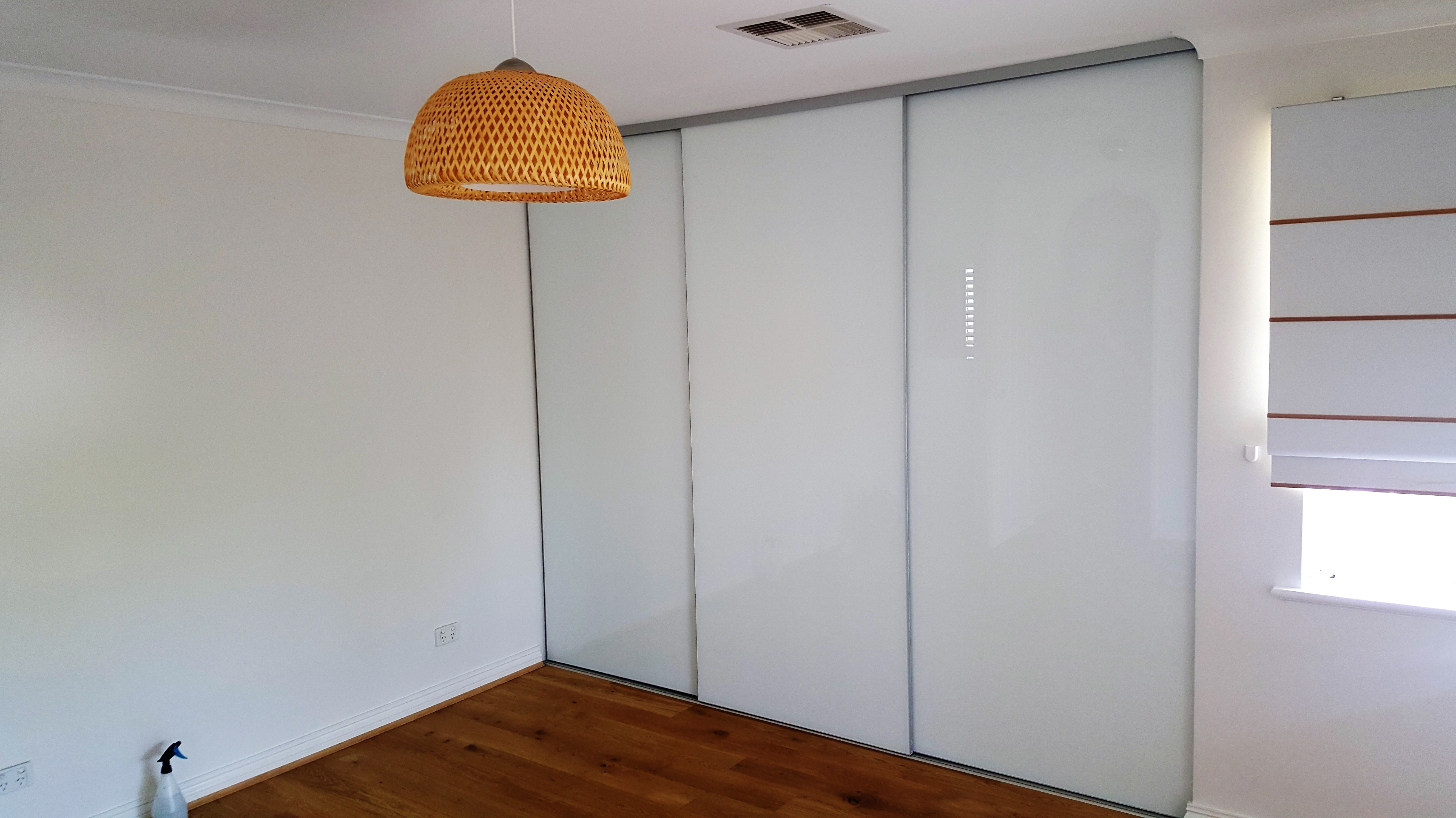 Three Door Frameless Sliding Wardrobe Doors with White Glass